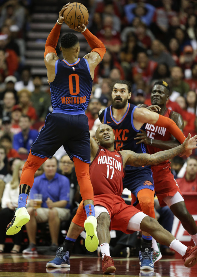 Photo -  Oklahoma City's Russell Westbrook takes a shot during Tuesday's game at Houston. Westbrook was whistled for his 10th technical foul of the season during the game, just five away from an NBA suspension. [AP PHOTO]