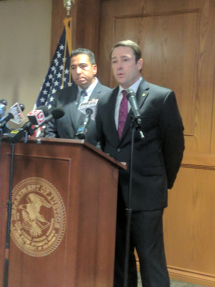 Photo - United States Attorney Mark A. Yancey speaks at a Monday news conference, while FBI Assistant Special Agent in Charge Raul Bujanda listens.