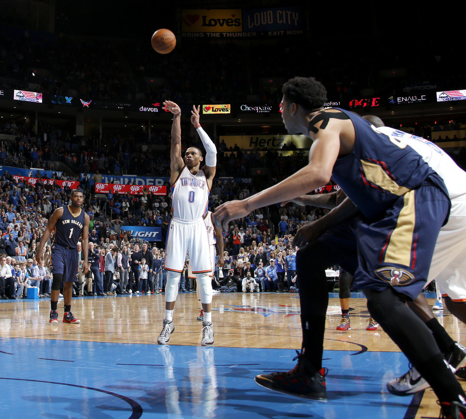 Photo - Oklahoma City's Russell Westbrook (0) makes a free throw to tie the game late in an NBA game between the Oklahoma City Thunder and the New Orleans Pelicans at Chesapeake Energy Arena on Friday, Feb. 6, 2015. Photo by Bryan Terry, The Oklahoman