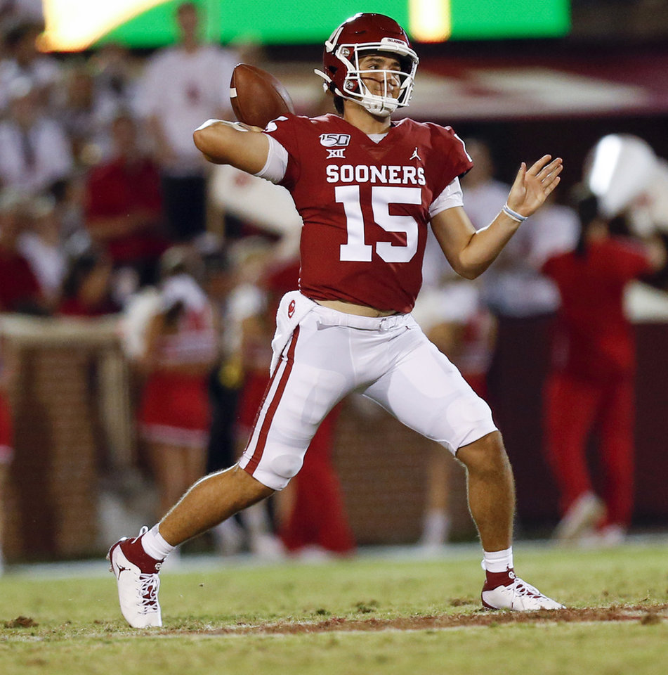 Photo - Oklahoma's Tanner Mordecai (15) passes in the fourth quarter during a college football game between the Oklahoma Sooners (OU) and South Dakota Coyotes at Gaylord Family - Oklahoma Memorial Stadium in Norman, Okla., Saturday, Sept. 7, 2019. [Nate Billings/The Oklahoman]
