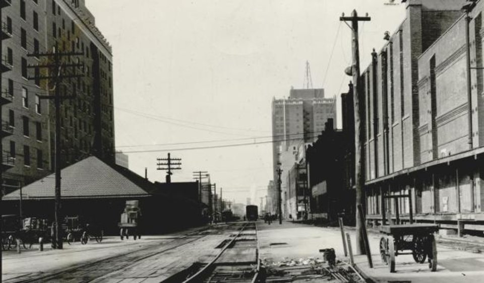 Photo -  Looking west down the Rock Island tracks, with its station on the left. [THE OKLAHOMAN ARCHIVES]