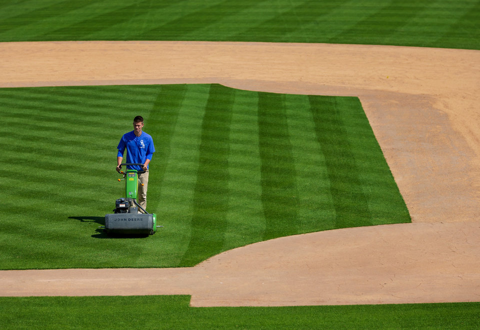 Photo - Head Groundskeeper Jeff Jackson mows the infield at the Chickasaw Bricktown Ballpark in Oklahoma City, Okla. on Friday, April 10, 2020. [Chris Landsberger/The Oklahoman]