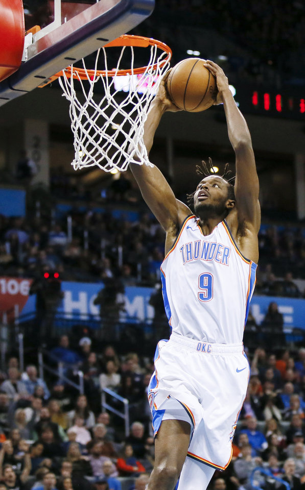 Photo -  Oklahoma City's Jerami Grant dunks the ball during Monday's game at Chesapeake Energy Arena. [Photo by Nate Billings, The Oklahoman]