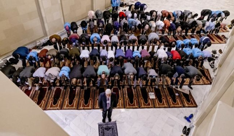 Photo -  Imad Enchassi, senior imam of the Islamic Society of Greater Oklahoma City, leads a group in prayer during