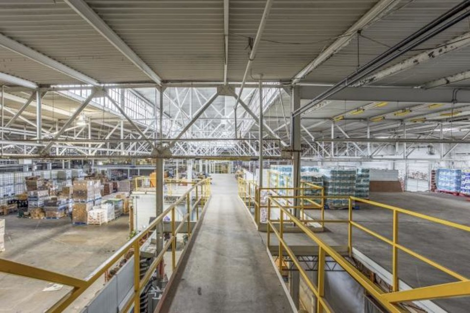 Photo -  The former NuWay Laundry includes extensive warehouse space. [Lindsey Torres Photography]