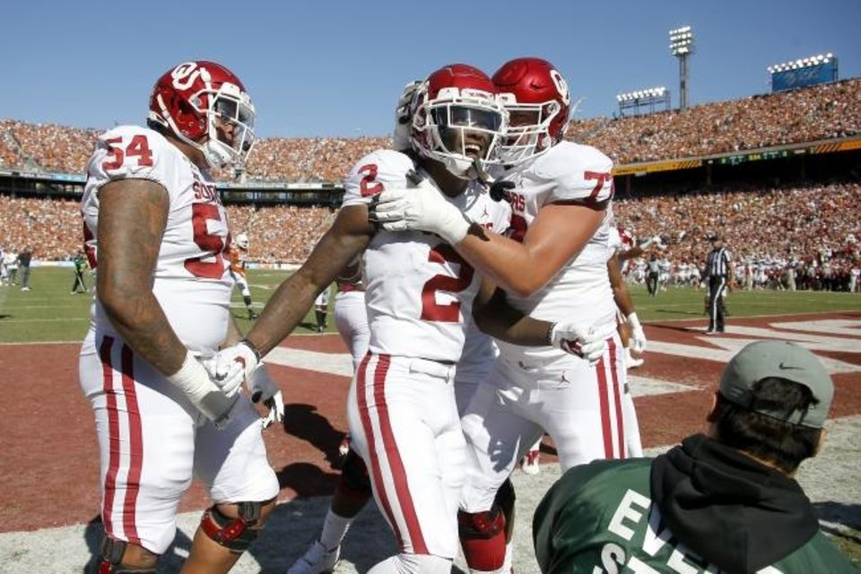 Photo -  Oklahoma's CeeDee Lamb (2) celebrates with Marquis Hayes (54) and Erik Swenson (77) after a touchdown during the Red River Showdown college football game between the University of Oklahoma Sooners (OU) and the Texas Longhorns (UT) at Cotton Bowl Stadium in Dallas, Saturday, Oct. 12, 2019. Oklahoma won 34-27. [Bryan Terry/The Oklahoman]