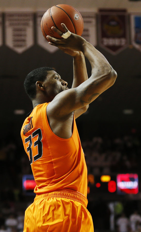 Photo - Oklahoma State's Marcus Smart (33) takes a shot in the first half during the NCAA men's Bedlam basketball game between the Oklahoma State Cowboys (OSU) and the Oklahoma Sooners (OU) at Lloyd Noble Center in Norman, Okla., Monday, Jan. 27, 2014. Photo by Nate Billings, The Oklahoman