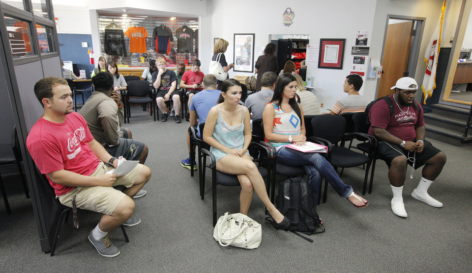 Photo -  Students enrolling or changing classes wait to see advisers in the main office at Northern Oklahoma College in Stillwater Monday, Aug. 18, 2014. Photo by Paul B. Southerland, The Oklahoman   PAUL B. SOUTHERLAND -  PAUL B. SOUTHERLAND