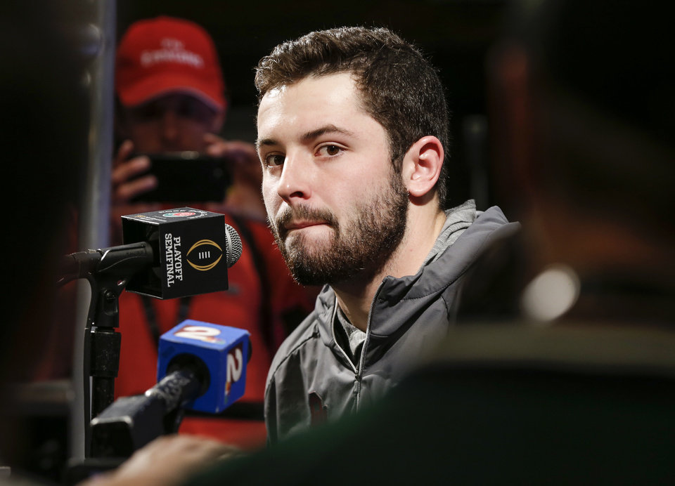 Photo -  Affected by flu-like symptoms, Baker Mayfield answered questions for about 20 minutes at Saturday morning's media day. [PHOTO BY NATE BILLINGS, THE OKLAHOMAN]