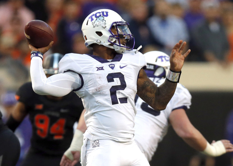 Photo - TCU's Trevone Boykin (2) looks to throw a pass in the third quarter during the college football game between the Oklahoma State Cowboys (OSU) and TCU Horned Frogs at Boone Pickens Stadium in Stillwater, Okla., Saturday, Nov. 7, 2015. Photo by Sarah Phipps, The Oklahoman