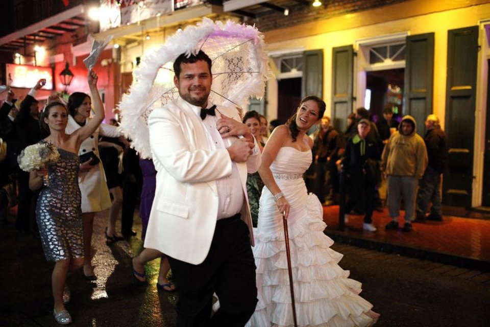 Photo -  A wedding party parades down Bourbon Street in the French Quarter New Year's Eve, Tuesday, Dec. 31, 2013 in New Orleans. Photo by Sarah Phipps, The Oklahoman