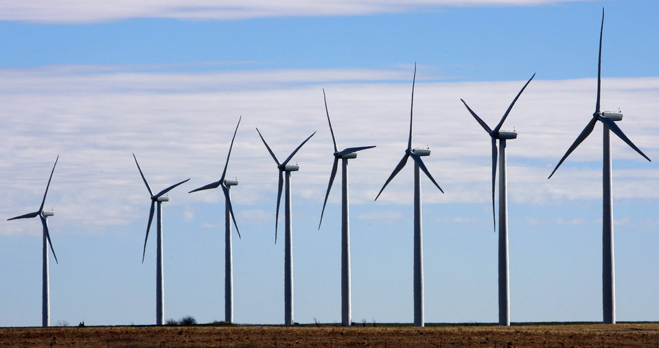 Photo -  Developments in renewable energy have offered consumers more choices, experts said Thursday at the University of Oklahoma Energy Symposium. This photo shows a wind farm near Weatherford. [THE OKLAHOMAN ARCHIVES]