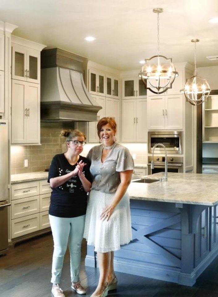 Photo -  Allison Richey, right, founder of The Sparrow Project, stands with her daughter, Casey, in the kitchen of The Sparrow Show Home, built by Craig Smith Building, at 12901 Endor Court. Tours of the decked-out home June-8-23 will raise money for the nonprofit. [JIM BECKEL/THE OKLAHOMAN]