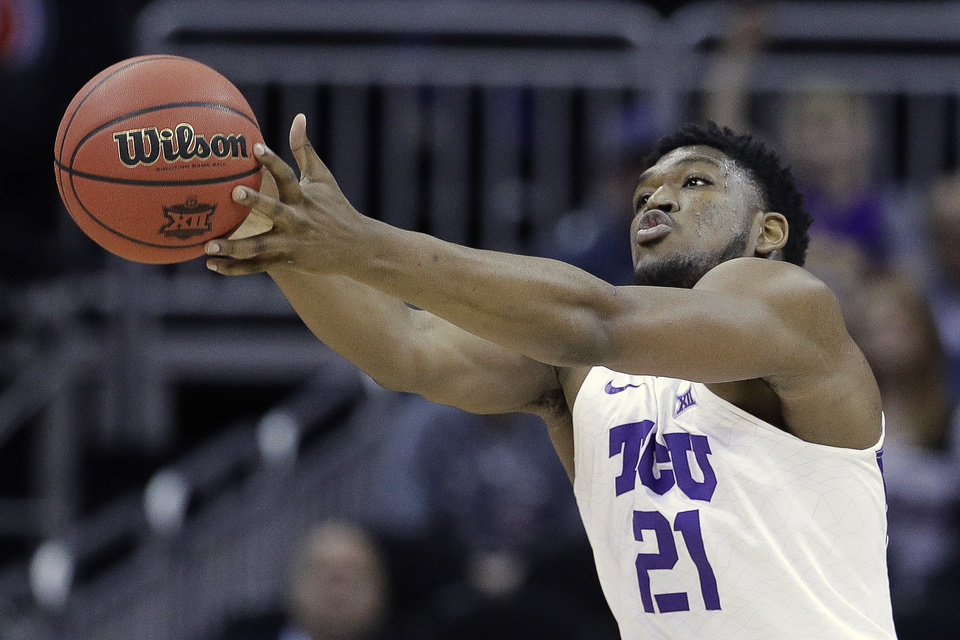 Photo - TCU's Kevin Samuel chases a loose ball during the first half of the team's NCAA college basketball game against Oklahoma State in the Big 12 men's tournament Wednesday, March 13, 2019, in Kansas City, Mo. (AP Photo/Charlie Riedel)