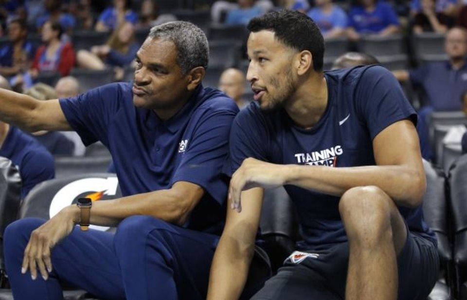 Photo -  Thunder assistant coach Maurice Cheeks (left) talks with Andre Roberson during the Thunder Blue and White Scrimmage in 2018. Cheeks has extensive head-coaching experience in the NBA. [Sarah Phipps/The Oklahoman]