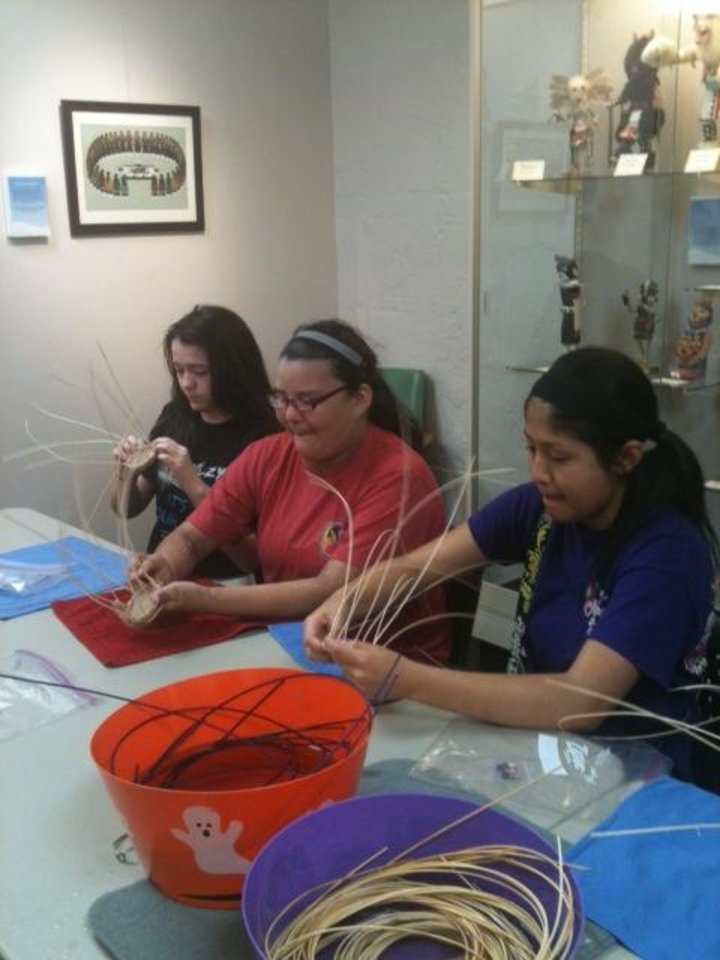 Photo - Students learn the art of Cherokee basket making during a hands-on educational experience at the Red Earth Art Center in downtown Oklahoma City. Photo provided by Red Earth.
