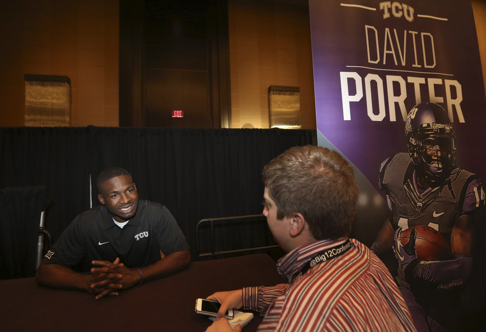 Photo - TCU wide receiver David Porter speaks to a reporter during the NCAA college Big 12 Conference Football Media Days in Dallas, Monday, July 21, 2014. (AP Photo/LM Otero)