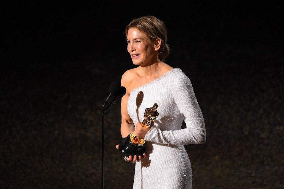 Photo - Renee Zellweger accepts the award for best performance by an actress in a leading role for her role in