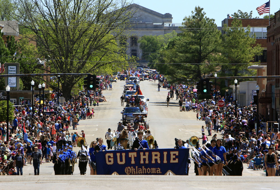 Photo -  Members of the Guthrie High School Band march in the '89er Celebration parade.  [Photo by Paul Hellstern, The Oklahoman]