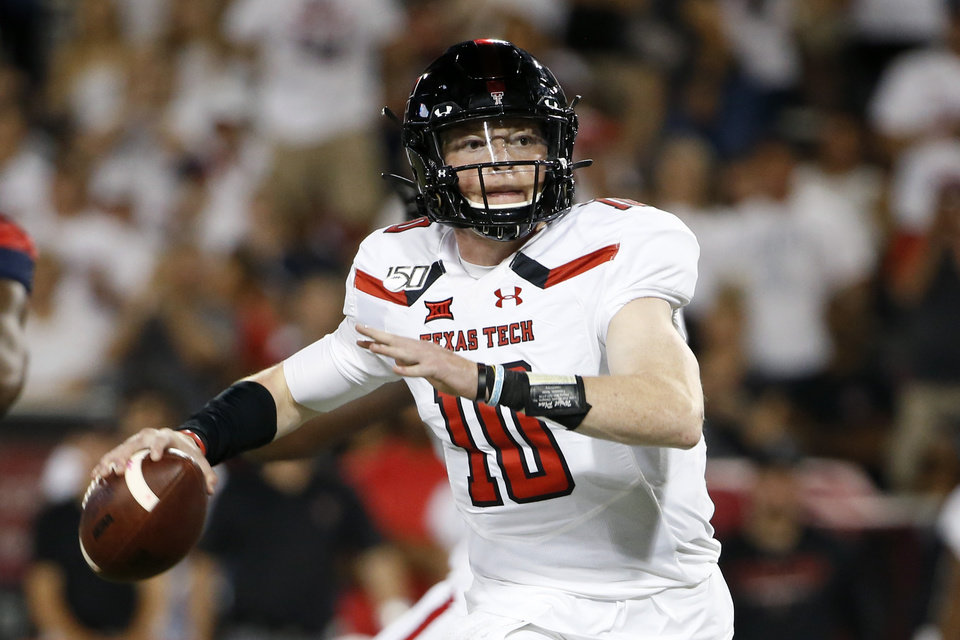 Photo - Texas Tech quarterback Alan Bowman (10) looks to pass the ball against Arizona during the second half of an NCAA college football game, Saturday, Sept. 14, 2019, in Tucson, Ariz. Arizona defeated Texas Tech 28-14. (AP Photo/Ralph Freso)