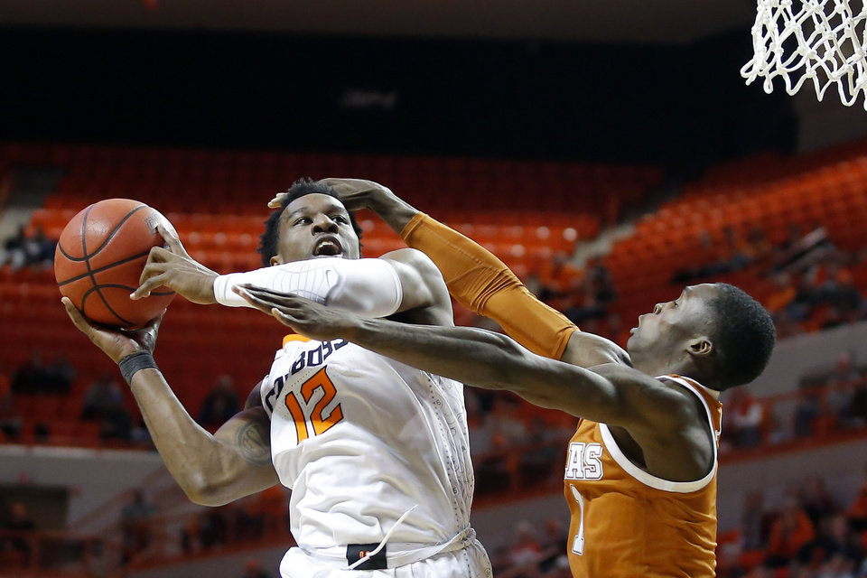 Photo - Oklahoma State's Cameron McGriff (12) is fouled by Texas' Andrew Jones (1) during an NCAA basketball game between the Oklahoma State University Cowboys (OSU) and the Texas Longhorns at Gallagher-Iba Arena in Stillwater, Okla., Wednesday, Jan. 15, 2020. Oklahoma State lost 76-64. [Bryan Terry/The Oklahoman]