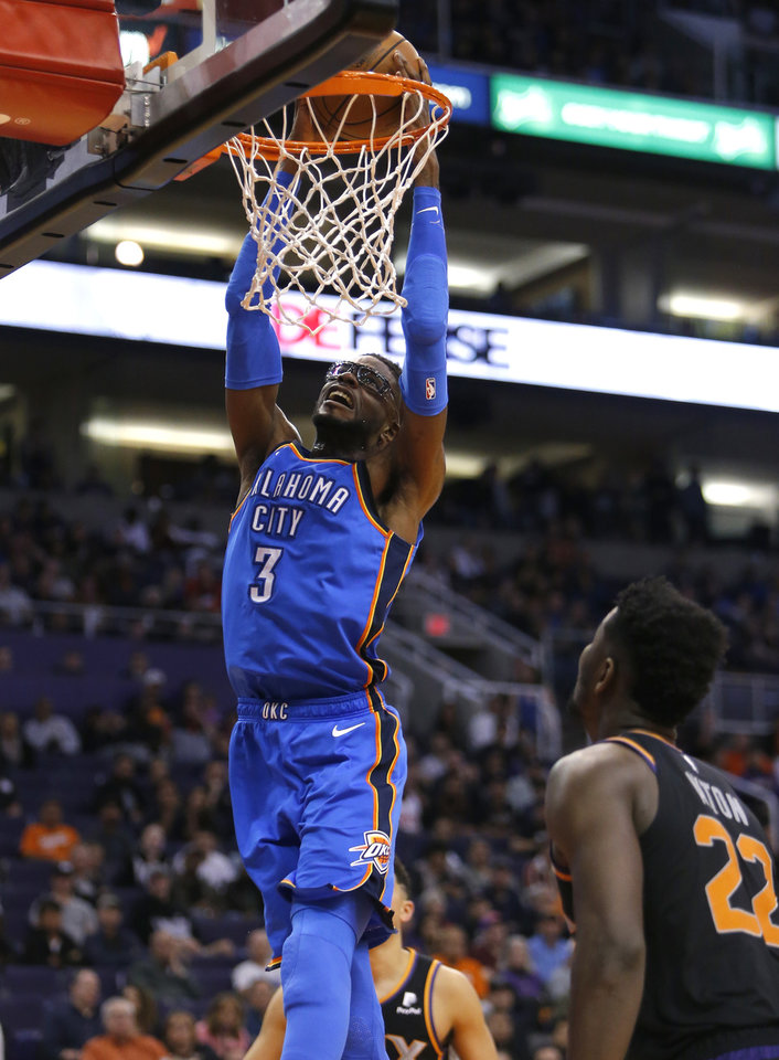 Oklahoma City Thunder forward Nerlens Noel (3) dunks against the Phoenix  Suns during the second half of an NBA basketball game Saturday, Nov.