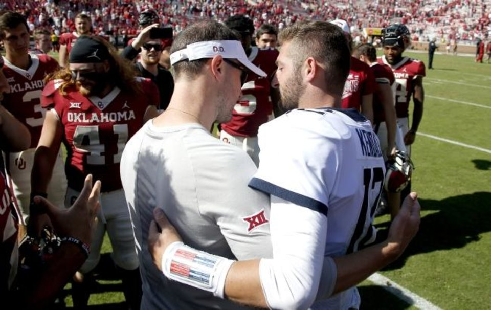 Photo -  Oklahoma coach Lincoln Riley talks with West Virginia's Austin Kendall after the Sooners' win in Norman on Saturday. [Bryan Terry/The Oklahoman]
