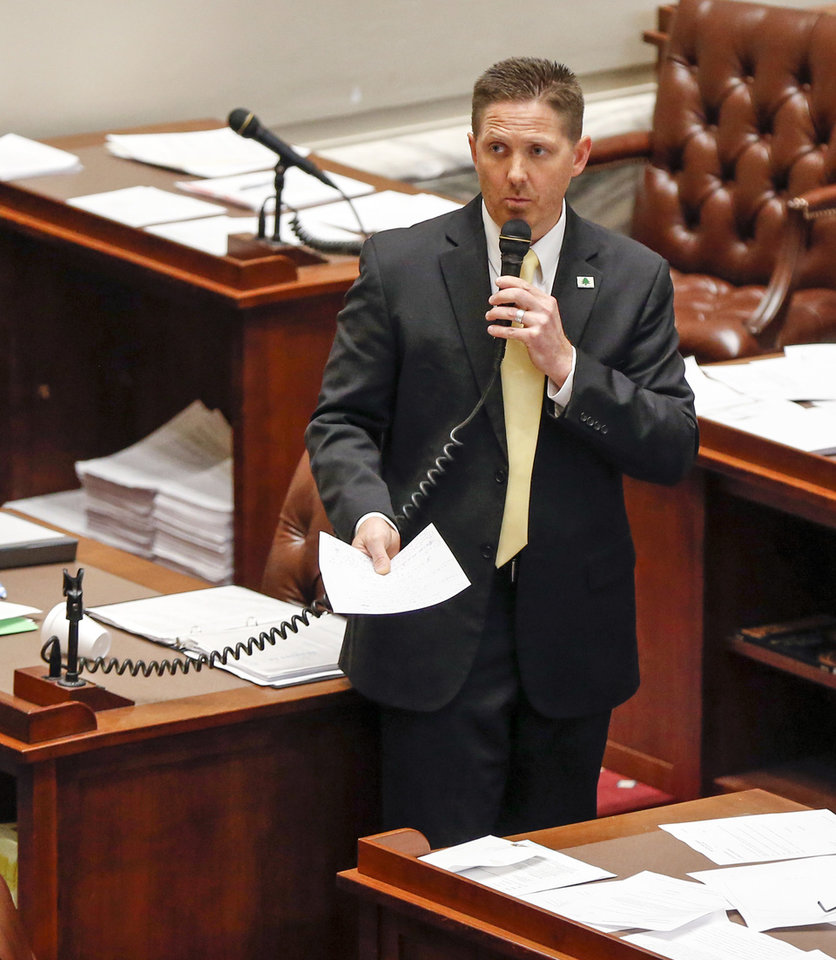 Photo - State Sen. Josh Brecheen, R-Coalgate, talks about one of his amendments to special session House Bill 1019XX on the Senate floor during the fifth day of a walkout by Oklahoma teachers at the state Capitol in Oklahoma City, Friday, April 6, 2018. Photo by Nate Billings, The Oklahoman