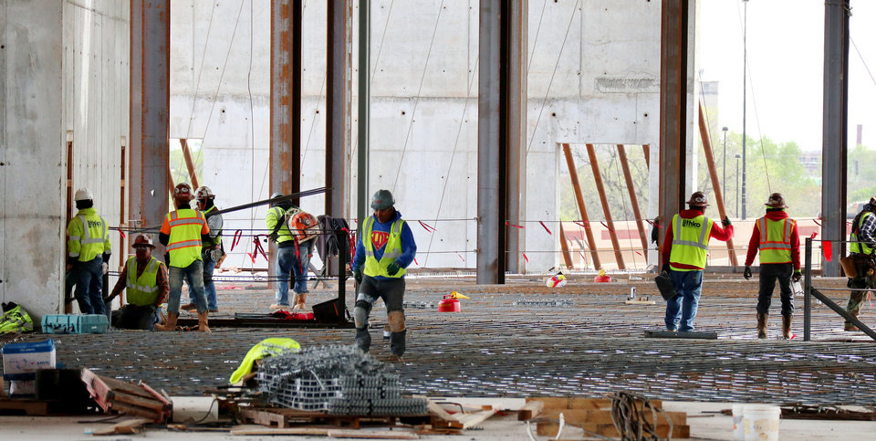 Photo - Workers assemble rebar for flooring. City of Oklahoma City tour of the construction site for the new convention center, Friday, April 12, 2019. Photo by Doug Hoke/The Oklahoman