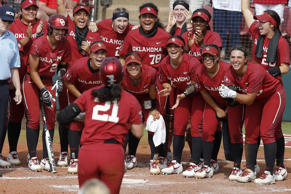 Photo - Oklahoma's Grace Green (21) is greeted by her teammates at home after hitting a home run in the third inning of the second softball game in the Norman Super Regional between the University of Oklahoma (OU) and Northwestern in Norman, Okla., Saturday, May 25, 2019. Oklahoma won 8-0 to send them to the Women's College World Series. [Bryan Terry/The Oklahoman]