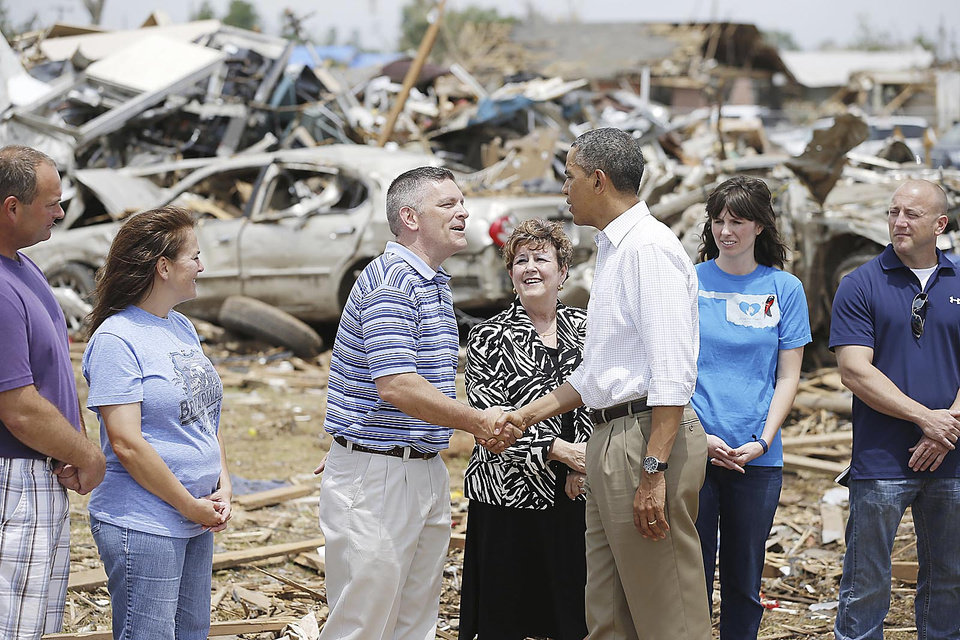 Photo - Left: The president greets Robert Romines, Moore assistant superintendent, Susan Pierce, superintendent, and tornado victims at Plaza Towers Elementary in Moore. Photos by Bryan Terry, The Oklahoman