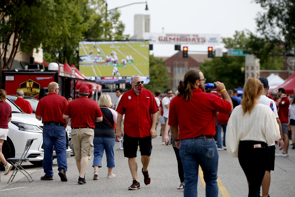 Photo - A crowd visits Campus Corner before a college football game between the University of Oklahoma Sooners (OU) and Missouri State in Norman, Okla., Saturday, Sept. 12, 2020. [Bryan Terry/The Oklahoman]