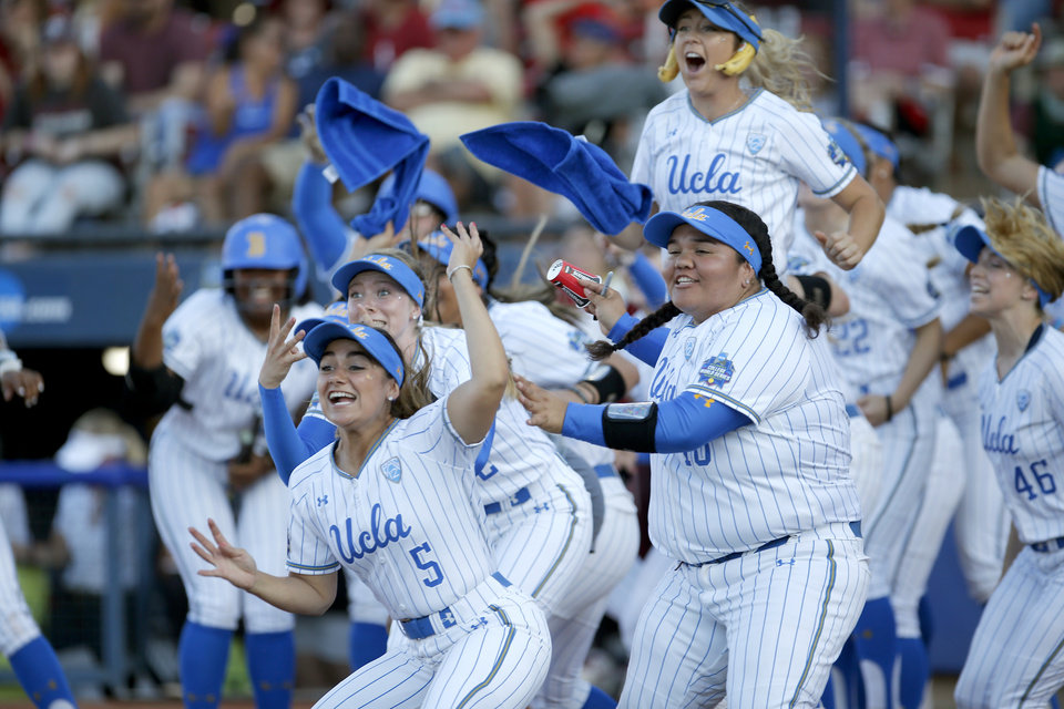 Photo - UCLA celebrates a Briana Perez (3) home run in the 1st inning during the second NCAA softball game in the championship series of the Women's College World Series between Oklahoma and UCLA at USA Softball Hall of Fame Stadium in Oklahoma City, Tuesday, June 4, 2019. [Sarah Phipps/The Oklahoman]