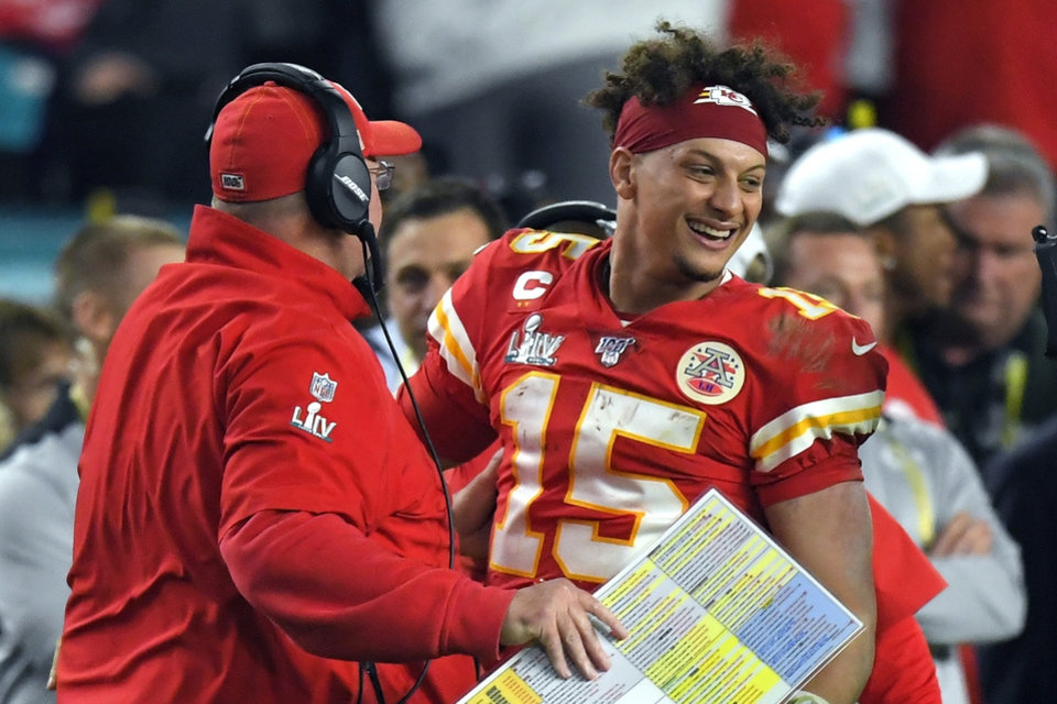 Photo - Kansas City Chiefs head coach Andy Reid, center, and quarterback Patrick Mahomes celebrate after defeating the San Francisco 49ers in the NFL Super Bowl 54 football game Sunday, Feb. 2, 2020, in Miami Gardens, Fla. (AP Photo/Mark J. Terrill)