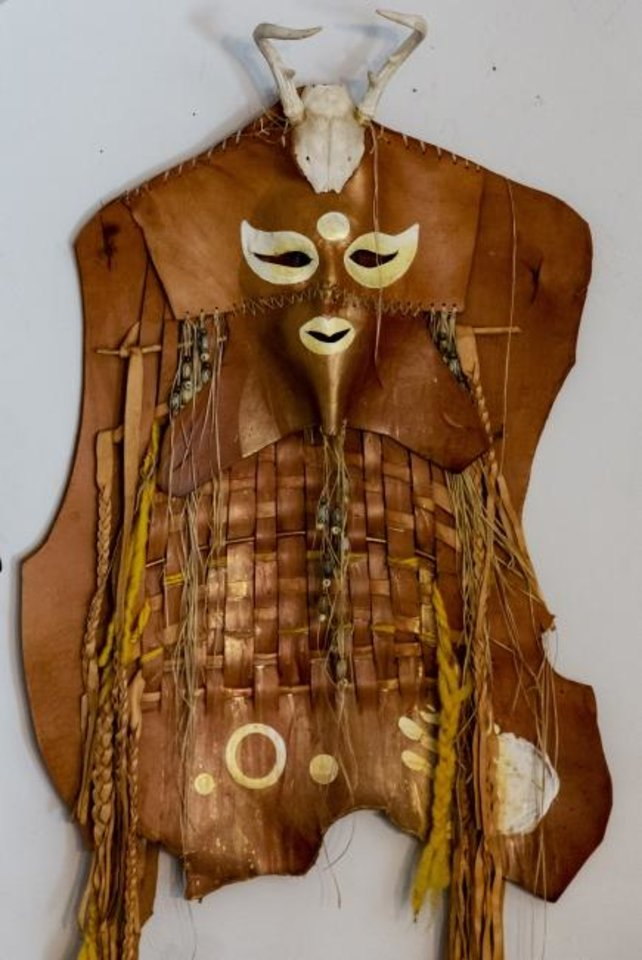 Photo -  A leather mask created by G. Patrick Riley is displayed at his home studio in Bethany on July 29. Riley, who is renowned for his colorful masks, has a variety of his work on view in the exhibit
