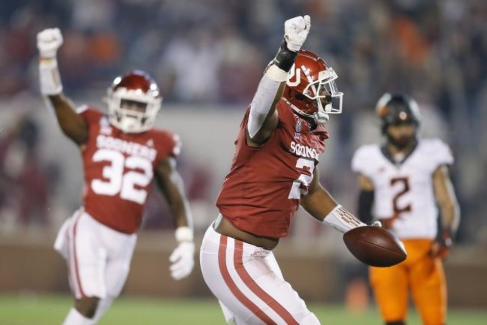 Photo -  Oklahoma's David Ugwoegbu (2) celebrates after an interception during a bedlam college football game between the University of Oklahoma Sooners (OU) and the Oklahoma State Cowboys (OSU) at Gaylord Family-Oklahoma Memorial Stadium in Norman, Okla., Saturday, Nov. 21, 2020. [Bryan Terry/The Oklahoman]