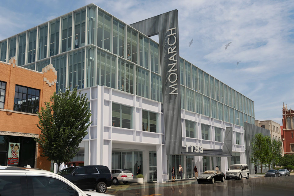 Photo -  The Monarch Building design starts with a two-story white steel-and-glass facade with a two-story