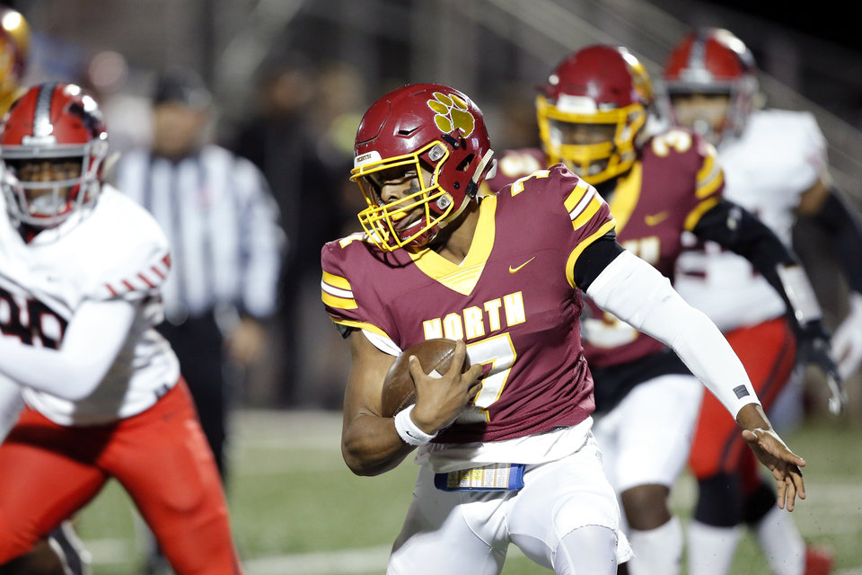 Photo - Putnam City North's Aaron Norment carries the ball during a high school football game between Putnam City North and Mustang in Oklahoma City, Friday, Nov. 1, 2019.  [Bryan Terry/The Oklahoman]