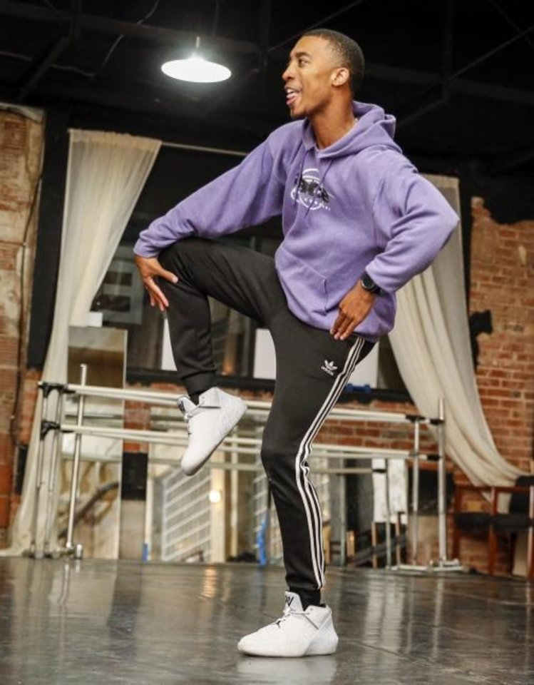 Photo -  Chris Shepard dances during a 2018 rehearsal for