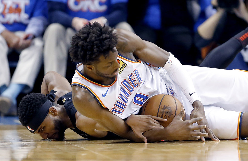 Photo - Oklahoma City's Jerami Grant (9) and Maurice Harkless (4) fight for a loose ball during Game 4 in the first round of the NBA playoffs between the Portland Trail Blazers and the Oklahoma City Thunder at Chesapeake Energy Arena in Oklahoma City, Sunday, April 21, 2019. Portland won 111-98. Photo by Sarah Phipps, The Oklahoman