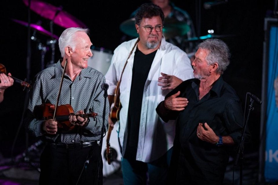 Photo - From left, Byron Berline, Vince Gill and Larry Gatlin appear on stage Tuesday night at