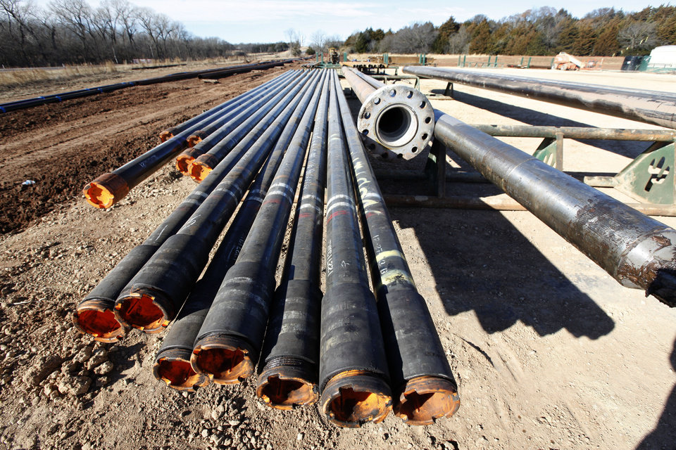 Photo - Pipe is stacked up near a Devon Energy drilling rig a few miles east of Perry .  Photo by Paul Hellstern, The Oklahoman Archives  PAUL HELLSTERN -  Oklahoman