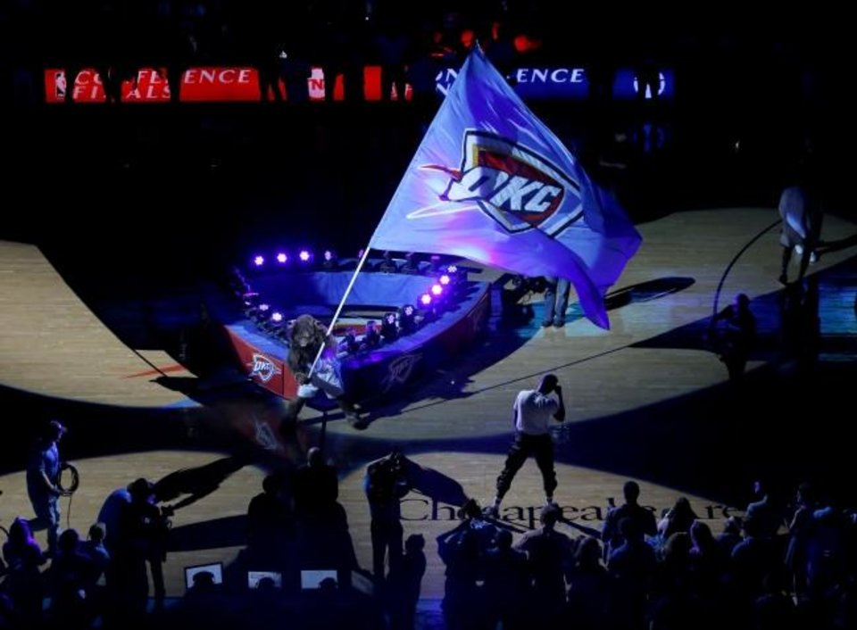 Photo -  Rumble the Bison carries a Thunder flag before game Game 6 of the 2016 Western Conference finals in the NBA playoffs between the Oklahoma City Thunder and the Golden State Warriors at Chesapeake Energy Arena. The arena, almost shelved when the original MAPS budget fell short, has brought Oklahoma City worldwide attention and an array of concerts and events that previously were going elsewhere. [The Oklahoman Archives]