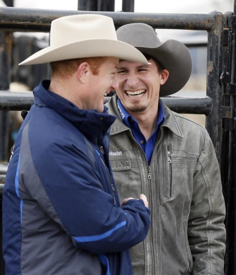 Photo -  Bull rider Ryan Dirteater, right, laughs with retired bull rider and now stock contractor Cord McCoy during a promotional event Thursday at the National Cowboy and Heritage Museum for the PBR's Express Classic Invitational on Friday and Saturday. Dirteater has drawn one of McCoy's bucking bulls, Midnight Rock, on Friday night. [Nate Billings/The Oklahoman]