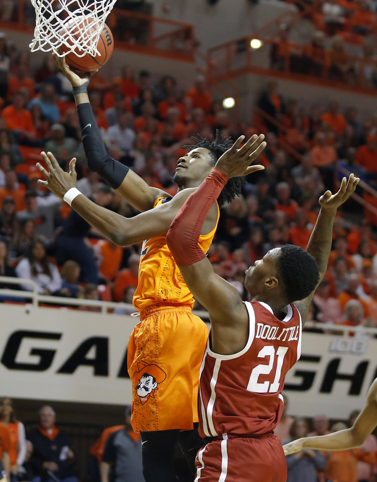 Photo - Oklahoma State's Kalib Boone (22) goes past Oklahoma's Kristian Doolittle (21) during an NCAA men's Bedlam basketball game between the Oklahoma State University Cowboys (OSU) and the University of Oklahoma Sooners (OU) at Gallagher-Iba Arena in Stillwater, Okla., Saturday, Feb. 22, 2020. Oklahoma State won 83-66. [Bryan Terry/The Oklahoman]