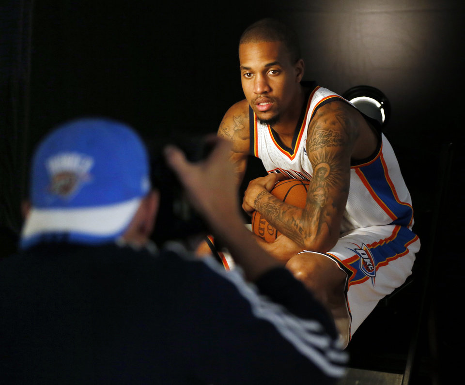 Photo - Eric Maynor has his photograph taken during media day for the Oklahoma City Thunder NBA basketball team at the Thunder Events Center in Oklahoma City, Monday, Oct. 1, 2012.  Photo by Nate Billings, The Oklahoman