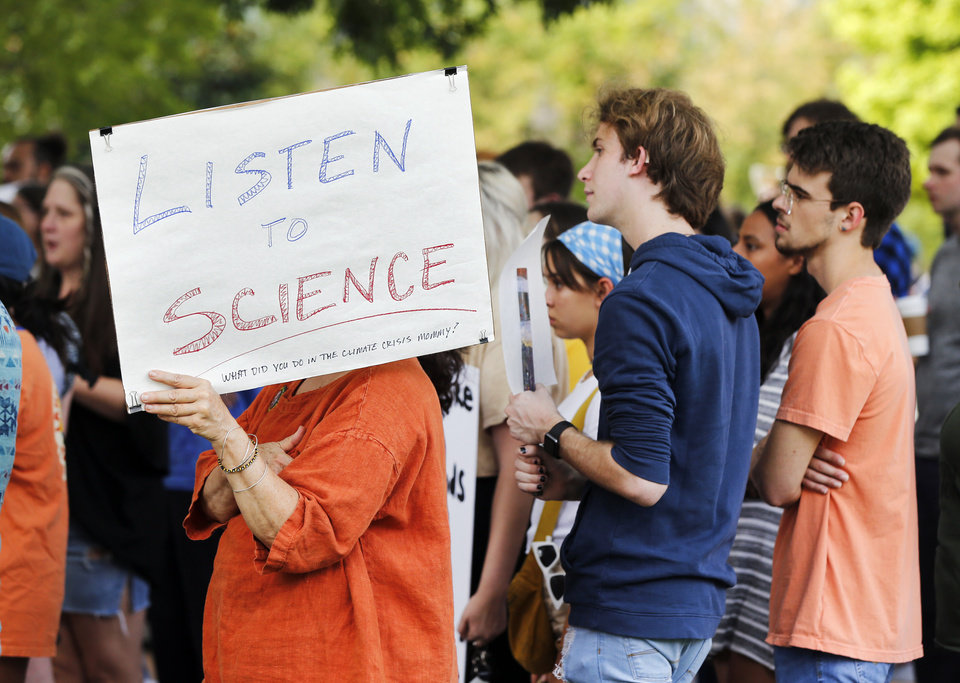 Photo - People listen to a speaker during the Oklahoma City Climate Strike event, part of global rallies and marches to bring attention to climate change, outside of City Hall in Oklahoma City, Friday, Sept. 20, 2019. [Nate Billings/The Oklahoman]