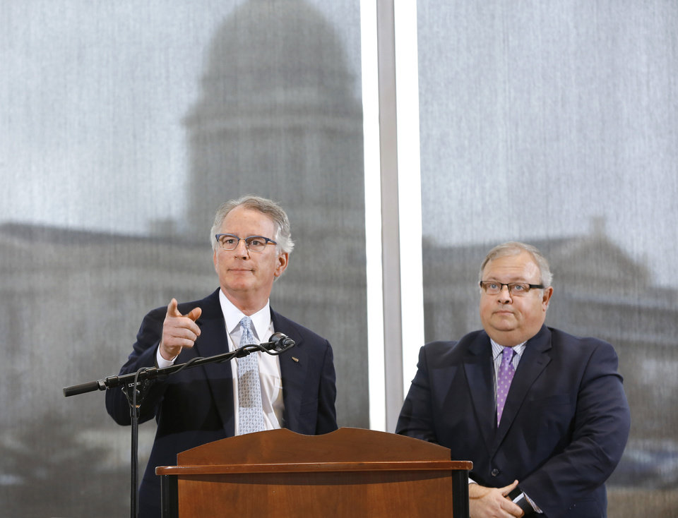 Photo -  David Rainbolt, an Oklahoma banker, left, and attorney Glenn Coffee, former state senator and Oklahoma Secretary of State, speak at a news conference. Coffee's law firm is due to receive $5.6 million in the Purdue opioid case settlement. [Jim Beckel/The Oklahoman]