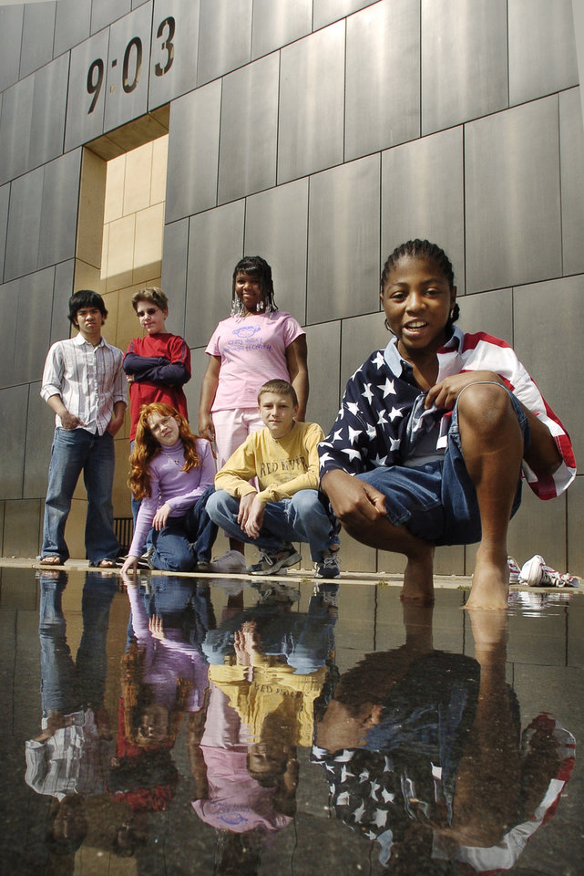 Photo - Christopher Nguyen, Brandon and Rebecca Denny, Nekia McCloud, Joe Webber and  P. J. Allen were survivors of the America's Kids day care facility destroyed in the bombing of the Alfred P. Murrah Federal Building on April 19, 1995 in Oklahoma City, Okla.  The survivors are reunited on Saturday, April 9, 2005, at the Memorial.    Photo by Steve Sisney/The Oklahoman