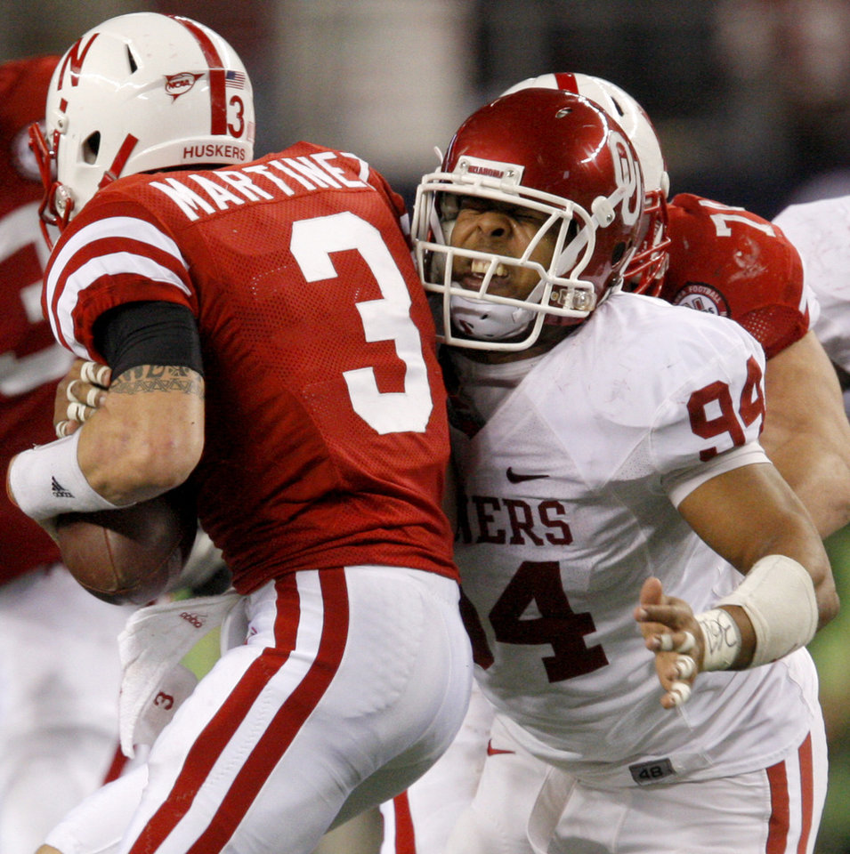 Photo - OU's Pryce Macon hits Nebraska's Taylor Martinez during the Big 12 football championship game between the University of Oklahoma Sooners (OU) and the University of Nebraska Cornhuskers (NU) at Cowboys Stadium on Saturday, Dec. 4, 2010, in Arlington, Texas.  Photo by Bryan Terry, The Oklahoman